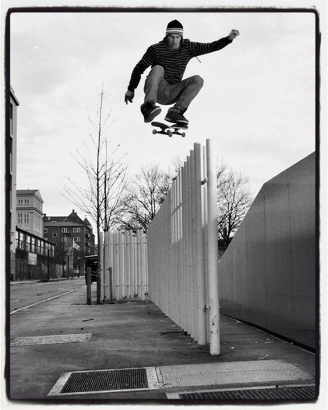 #flashbackfriday Chris Aström kickflip from bank over fence in Copenhagen, DK, 2006 #skateboarding #ollie #kickflip #streetskate #copenhagen #adio #bailgun #gerdriegerphotography